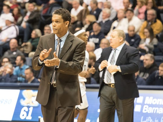 Monmouth head coach King Rice claps for his team during a timeout as  Monmouth University beat Canisius Monday night.