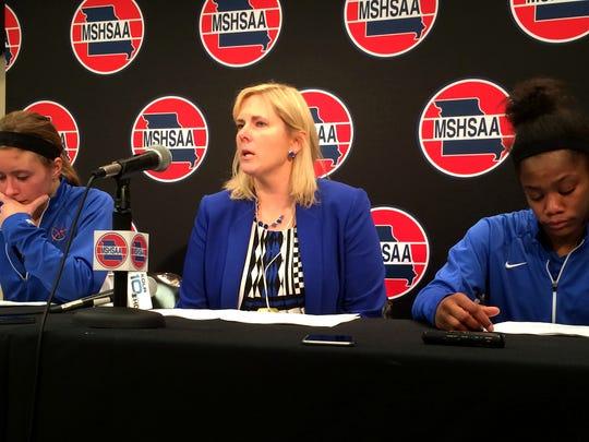From left, Hillcrest' Kelsie Cleeton, coach Jeni Hopkins