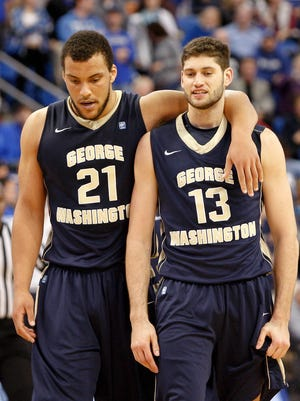 George Washington Colonials forward Kevin Larsen (21) consuls teammate Patricio Garino after he caused a foul against the Saint Louis Billikens late in the second half at Chaifetz Arena.