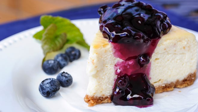A piece of blueberry cheesecake being served up at the Patisserie PariSco in Tamuning on July 8.