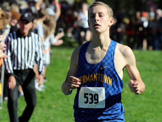 Germantown's Ben Schnoor crosses the finish line second during the boys Division 1 WIAA cross country sectional race at Lincoln Park.