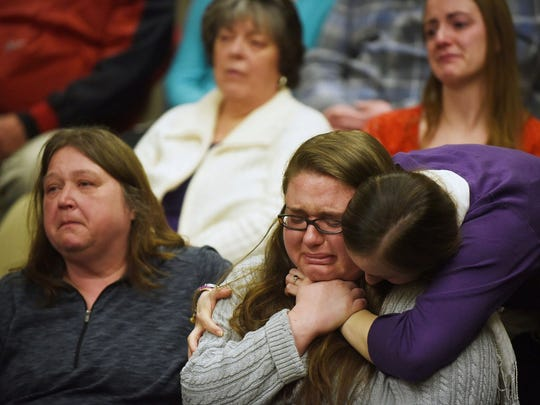 Amanda Murphy's mother, Tammy Langlois, and Murphy's sister, Ashley Murphy, cry after speaking about the moment they learned of the accident that killed Murphy, her unborn child, and her fiancee, Jason Timmons, during Robert Dellinger's sentencing at the Grafton County Superior Court in North Haverhill, N.H., on Wednesday, April 1, 2015.