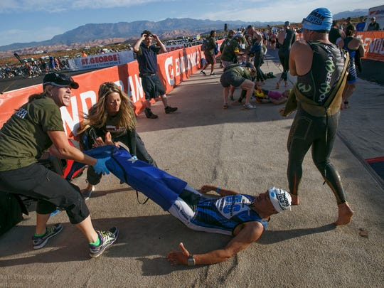 Ironman St. George competitors swim, bike and run during the 2105 running of the race Saturday, May 2, 2015.