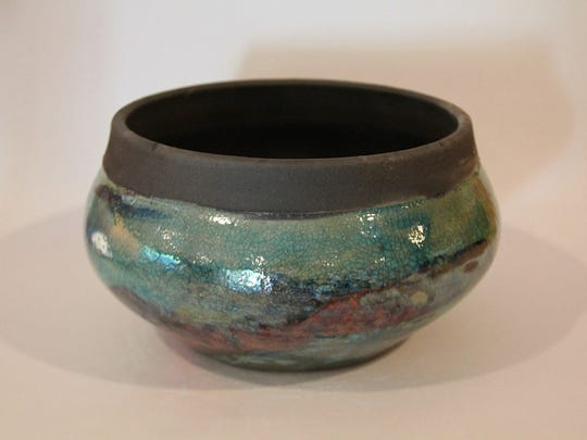 Susan Kopchains creates functional ceramic works such as this bowl, with overlapping glazes.