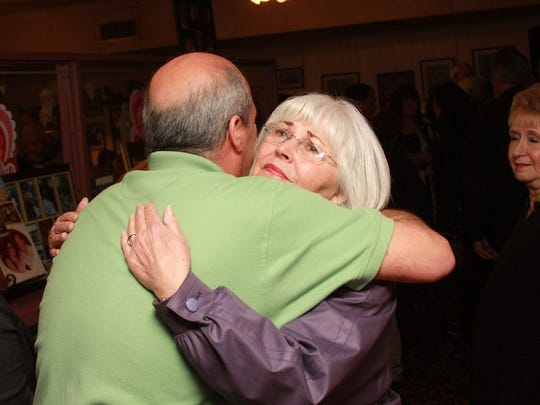 Newton Callahan hugs ZoAnn Eichaker during the Memorial Service  for Joan Kain at The Pancake House Saturday afternoon