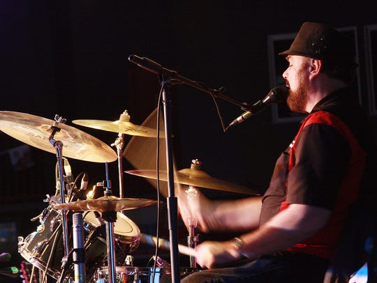 Drummer Tony Handley plays with Billy Mack and the