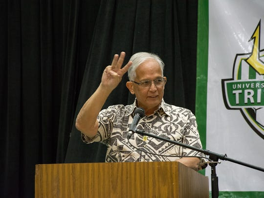 UOG President Robert A. Underwood throws out the Trident