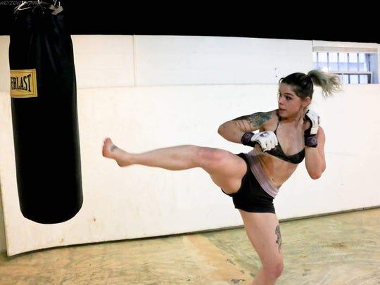 Shamir Peshwas practices her kicks.