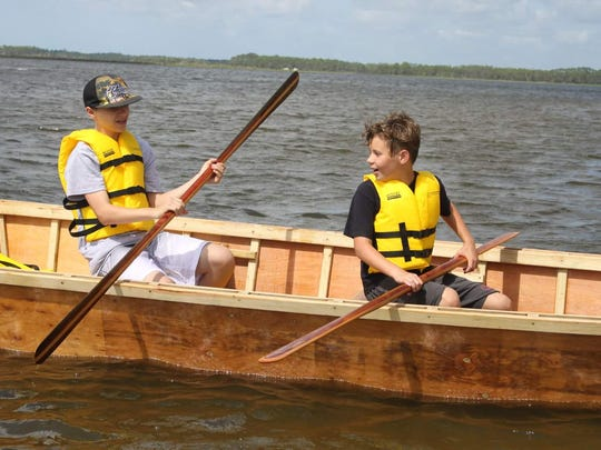 Campers take the finished skiff out for a spin.