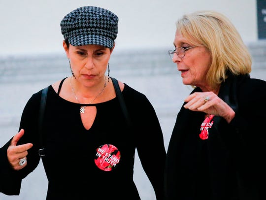 Two of Bill Cosby's accusers, Lili Bernard (L) and