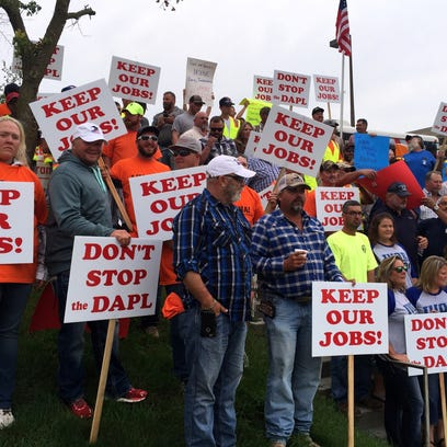 Pipeline workers rallied outside the Iowa Utilities