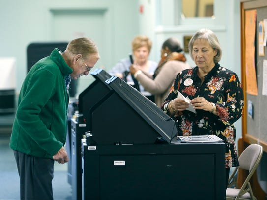 Will Sahmel casts his vote Tuesday as election inspector
