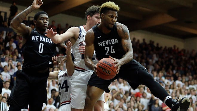 Nevada's Jordan Caroline, right, pulls in a rebound next to Saint Mary's Joe Rahon. He had a team-high eight rebounds but no other Nevada player had more than four.