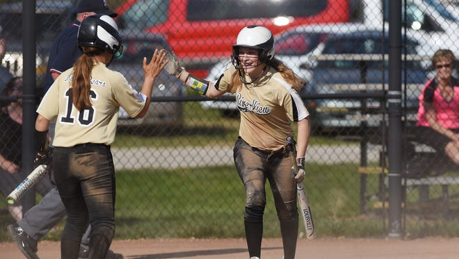 River View's Bailey Hettinger gets a high five from teammate Mikensi Ehlinger after scoring against Beaver Local.
