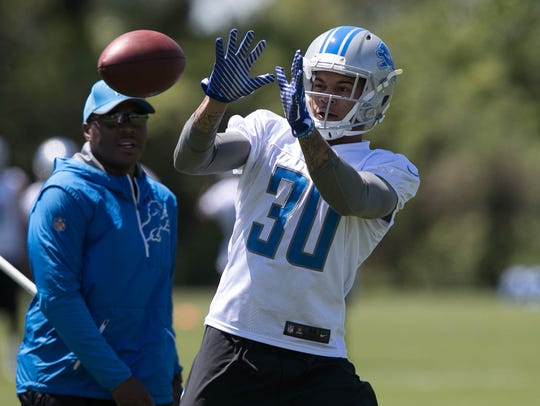 Lions rookie cornerback Teez Tabor catches balls after