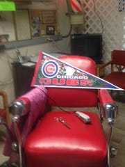 Darel Sterner's century-old barber's chair is draped