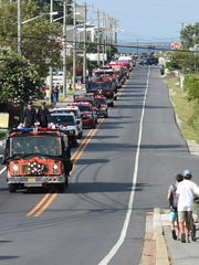 A motorcade of firefighting vehicles on its way to the funeral of firefighter Tim McClanahan.