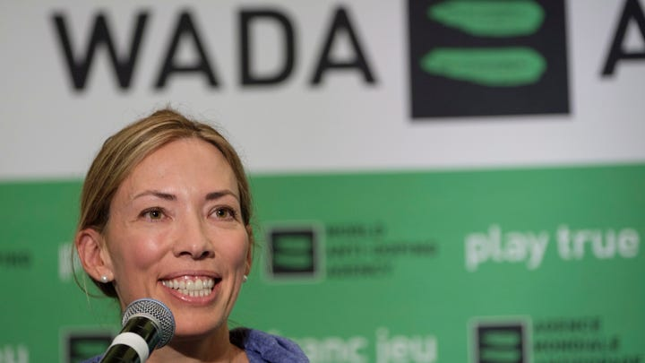 "FILE - In this June 5, 2018, file photo, Beckie Scott speaks at a news conference following the World Anti-Doping Agency's first Global Athlete Forum in Calgary, Alberta. A law firm found no evidence that WADA members bullied Scott, though it concluded that one member's comments to her ""could be viewed as aggressive, harsh or disrespectful."" WADA released a 58-page report Wednesday night, May 15, 2019, that was conducted to determine whether Scott, the Canadian Olympic champion, was bullied at a contentious meeting last September when officials lifted the suspension of Russia's anti-doping agency over her protest. (Jeff McIntosh/The Canadian Press via AP, File)"