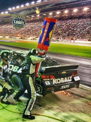 Brandon Harder provides fuel for Jimmie Johnson's No. 48 car. Harder and the rest of the team at Hendrick Motorsports was awarded top pit crew honors during an awards ceremony in Las Vegas last month.