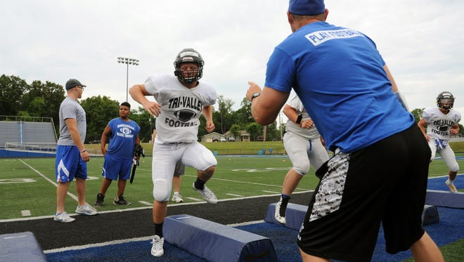 Tri-Valley's Grant Nolder goes through conditioning drills during the Muskingum Valley All-Stars practice Tuesday in Zanesville.