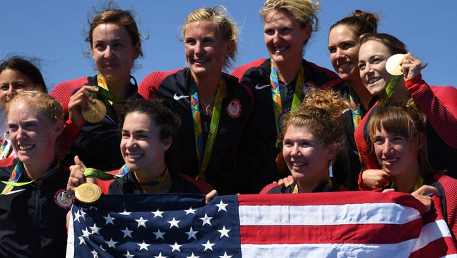 Members of the gold-medal winning USA women's rowing eights celebrate Saturday in Rio.