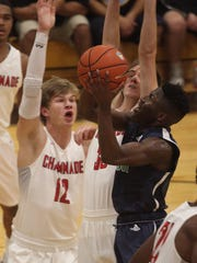 High Point Christian Academy's Michal Seals attempts a shot while defended by Chaminade's Isaac Olson and Marin Vrucinic during the battle for the 3rd place position at the City of Palms Classic on Wednesday.