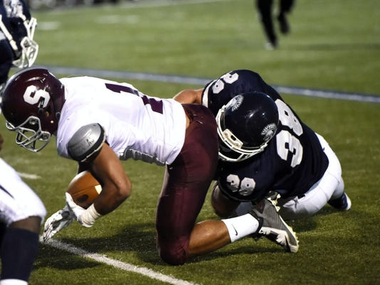 Chambersburg's Colten Brookens, right, makes a tackle against State College last season. Brookens was slected to play in the 14th annual PSFCA East-West All-Star game.
