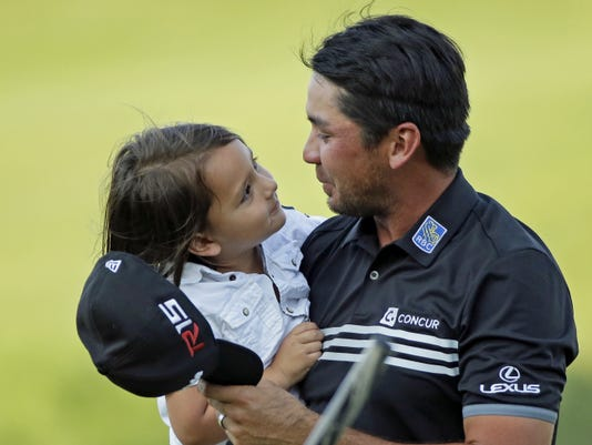 Jason Day, of Australia, holds his son Dash after winning the PGA Championship golf tournament Sunday, Aug. 16, 2015, at Whistling Straits in Haven, Wis. (AP Photo/Chris Carlson)