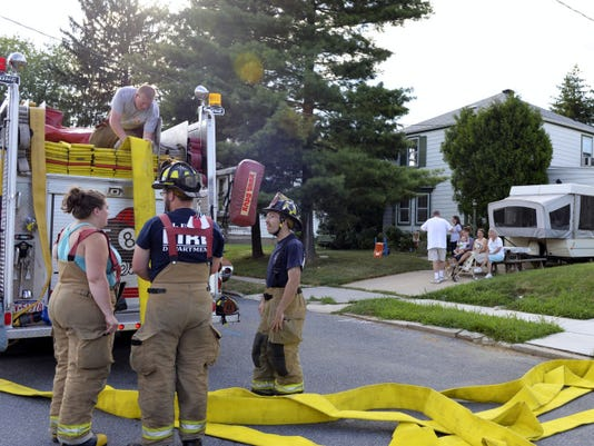 Cleona Fire Co. firefighters pack up hose after a call for a possible structure fire at 231 E. Maple Street in Cleona Saturday afternoon. Crews from Annville-Cleona Fire District and Lebanon returned to quarters shortly afterward.