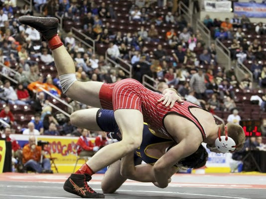 Bermudian Springs' Colton Dull wrestles Pope John Paul's Michael Collins during the third-place 182-pound match at the PIAA Class AA wrestling championships Saturday at Giant Center in Hershey. Dull scored a 1-0 victory to close his high school career with win No. 150.