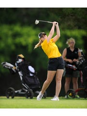 Blanket's Marki Kinkade tees off on the sixth hole of the first round of last year's Class 1A UIL state golf tournament  at Lions Municipal Golf Course in Austin.  She won the individual title.