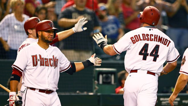 Sep 11, 2015: Arizona Diamondbacks first baseman Paul Goldschmidt (44) celebrates with teammates after hitting a two run home run in the second inning against the Los Angeles Dodgers at Chase Field.