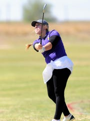 Wylie's Andrea Davis watches her shot on No. 15 during the first round of the Region I-4A tournament at the Shadow Hills Golf Club in Lubbock on April 25.