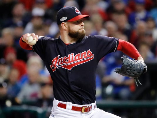 FILE - In this Oct. 14, 2016, file photo, Cleveland Indians starting pitcher Corey Kluber throws against the Toronto Blue Jays during Game 1 of baseball's American League Championship Series in Cleveland. Kluber, who confounded Chicago's hitters in Game 1 of the World Series with six scoreless, overpowering innings, will start Game 4 on three days' rest Saturday for the Indians, now two wins from their first Series title since 1948 after blanking the Cubs on Friday night, (AP Photo/Gene J. Puskar, File)