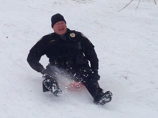Sgt. Scott Fulton going down a hill Wednesday in Mt. Juliet's Park Glen neighborhood.