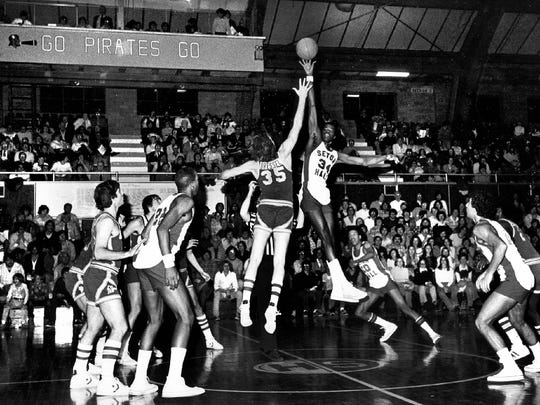 Glen Mosley (right) takes the opening tip at Walsh Gym in this undated photo.