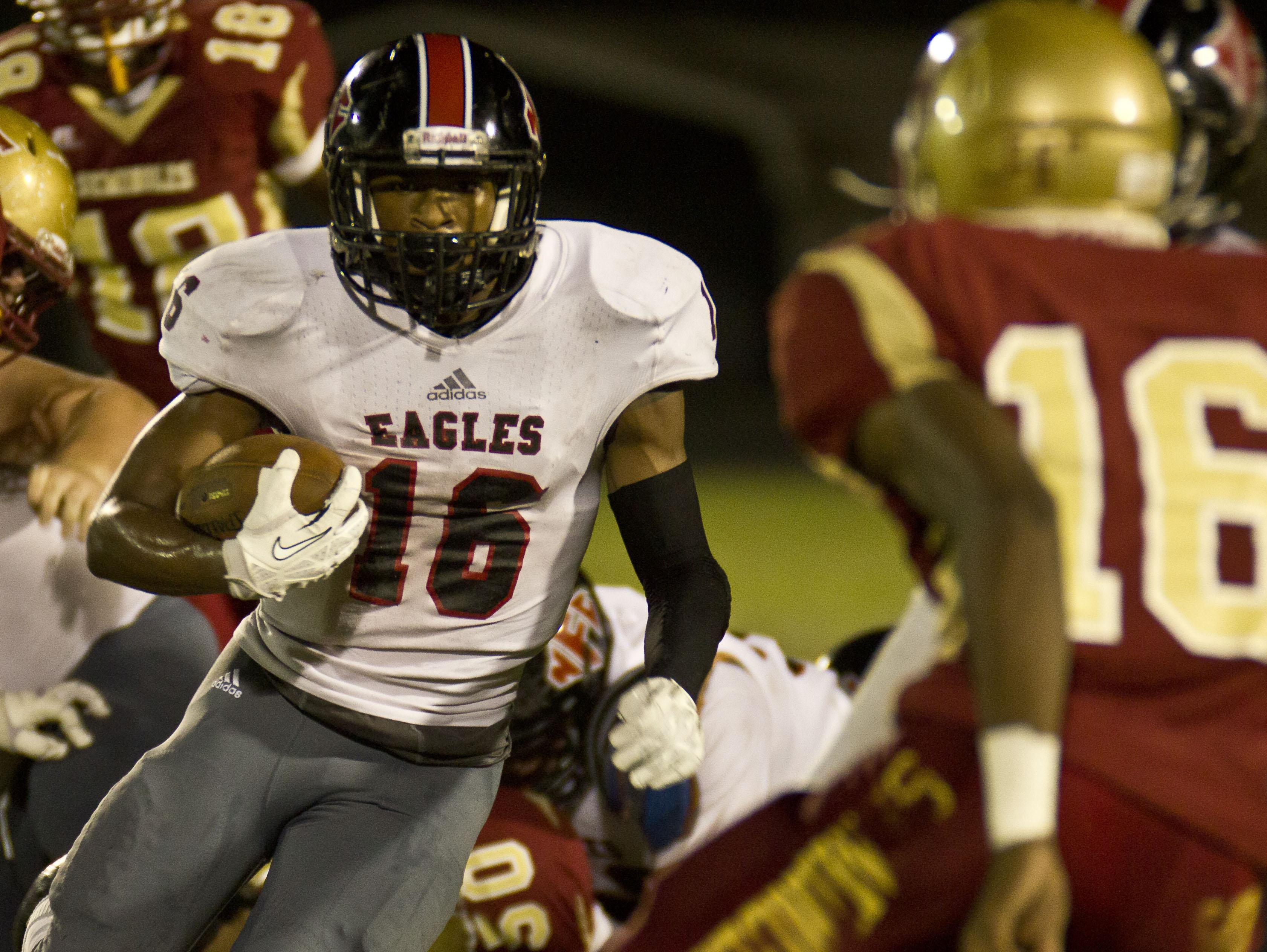 North Florida Christian running back Korey Charles runs for a gain against Florida High on Oct. 10, 2014.