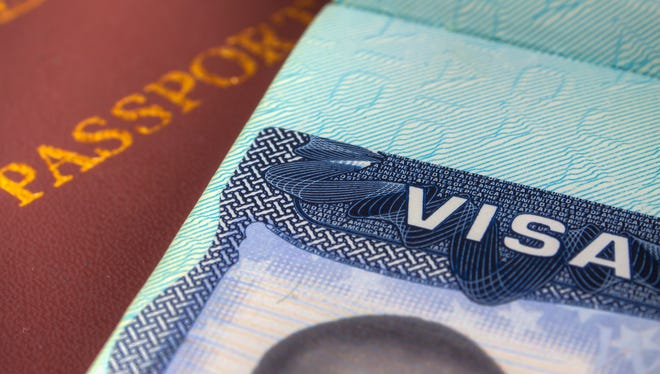 This Image was taken of a Passport and US Visa for Immigration purpose .