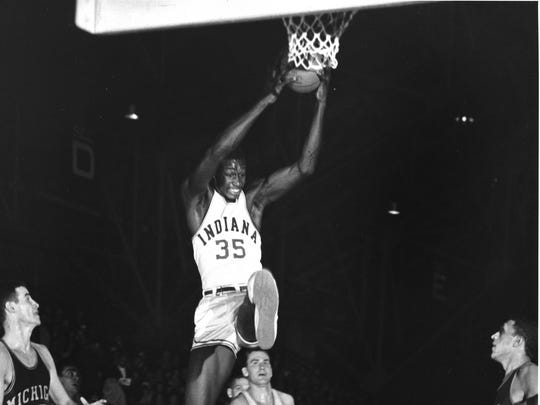 Former IU men's basketball All-American Walt Bellamy, the first Hoosier ever to be selected with the top pick in an NBA draft, pulls down a rebound against Michigan.