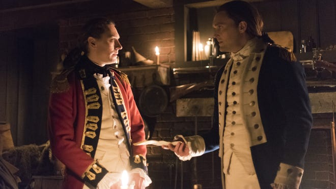 The room where it happend: Maj. John André (JJ Feild) and Gen. Benedict Arnold negotiate the surrender of West Point on AMC's 'Turn: Washington's Spies.'