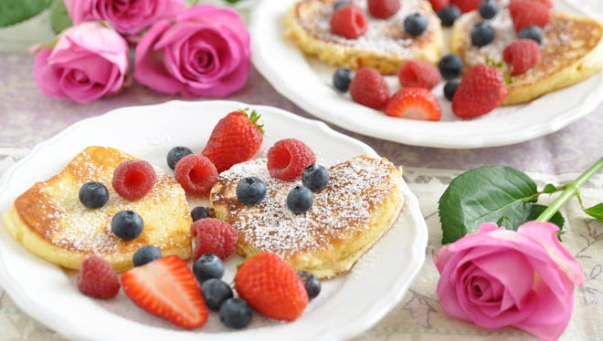 Heart shaped pancakes with fresh berries