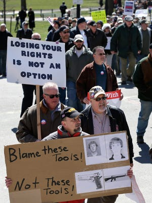 Gun owners and proponents in Boston demonstrate against Massachusetts gun control measures in 2013.