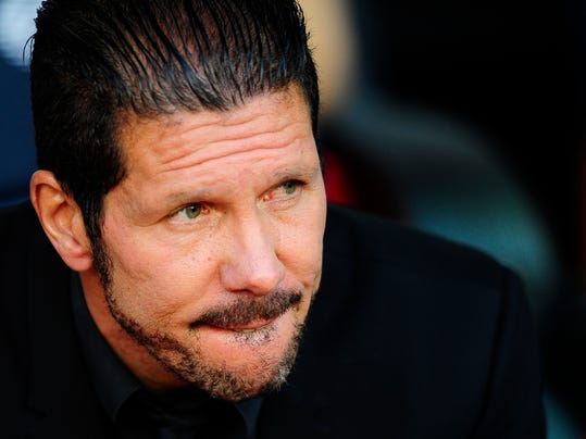 Atletico's coach Diego Simeone from Argentina gestures prior to a Spanish La Liga soccer match between FC Barcelona and Atletico Madrid at the Camp Nou stadium in Barcelona, Spain, Saturday, May 17, 2014. (AP Photo/Manu Fernandez)