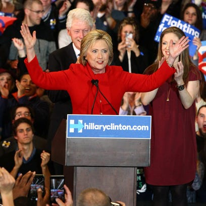 Democratic presidential candidate Hillary Clinton celebrates with her husband, former President Bill Clinton and their daughter, Chelsea, on caucus night at the Olmsted Center at Drake University in Des Moines, on Monday, Feb. 1, 2016.