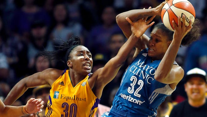 Minnesota Lynx forward Rebekkah Brunson, right, pulls down a rebound against Los Angeles Sparks forward Nneka Ogwumike during the second half in Game 4 of the WNBA basketball finals, Sunday, Oct. 1, 2017, in Los Angeles. The Lynx won 80-69.