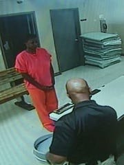 In this undated frame from video, Sandra Bland stands before a desk at Waller County Jail in Hempstead, Texas.