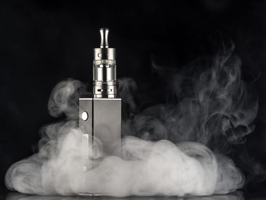 An example of an electronic cigarette over a dark background.