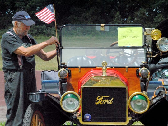 Cars at the event were adorned with Old Glory.