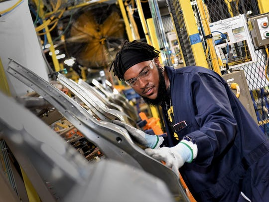 Rodney Washington, Ford employee, works on the door line in the all-new body shop at Chicago Assembly Plant.