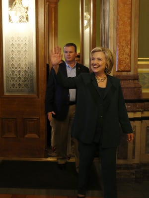 Democrat Hillary Clinton emerges from a meeting with Democratic legislators Wednesday, April 15, 2015, as Clinton makes a stop at the Iowa State Capitol in Des Moines, Iowa.